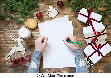 Christmas empty blank letter for Santa Claus with decor. Top view and space for your text. Flat lay.