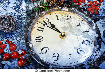 Christmas Eve and New Years at midnight. Clock covered with snow.