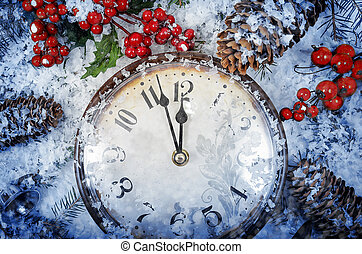 Christmas Eve and New Years at midnight. Clock covered with ...