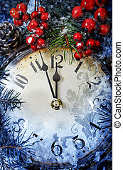 Christmas Eve and New Years at midnight. Clock covered with...