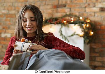 Christmas Eve - New Year. Beautiful girl celebrates ...