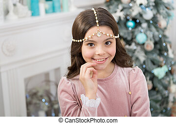 Christmas Eve. smiling cute child at home. happy new 2020 year. holiday party celebration. christmas home decoration. xmas shopping time. awaiting new year. pretty little princess celebrate christmas