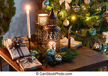 Christmas evening by candlelight. classic apartments with a fireplace,