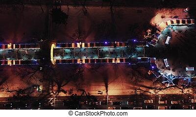 Christmas Fair. Lvov Town Hall. Christmas decorations and lights. Night time