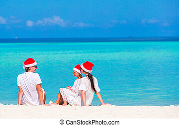 Christmas Family vacation on white beach