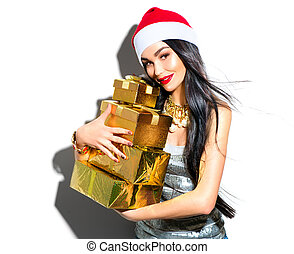 Christmas fashion model girl. Sexy Santa holding gifts