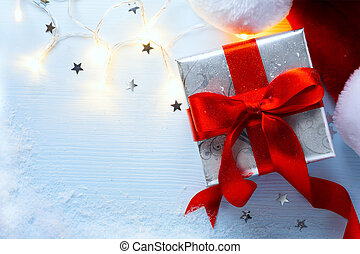 Christmas festive background with holidays light and gift box