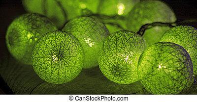 Christmas festive round green lights. macro