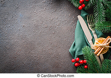 Christmas festive table setting with xmas decorations for christmas or new year dinner.