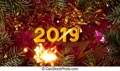 Christmas figures 2019 on a wooden background with sparkles and sparkler, the new year 2019, Christmas, sparks, background