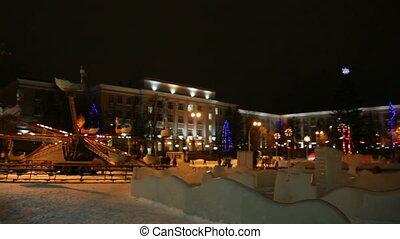 christmas fir and illuminated carousel