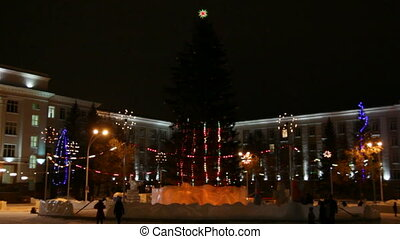 christmas fir on town square at night