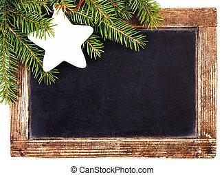 Christmas Fir Tree Branch on Blackboard with vintage wooden fram