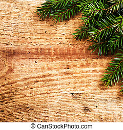 Christmas Fir Tree Branch on rustic  wooden background with copy
