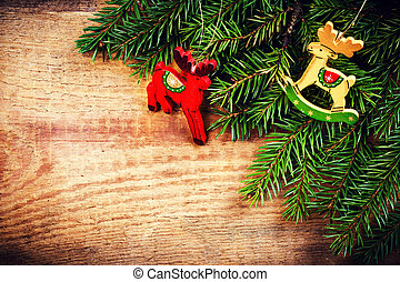 Christmas Fir Tree Branch on rustic wooden background with fest