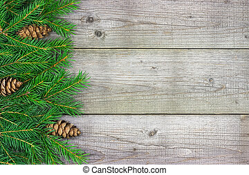 Christmas fir tree branch on rustic wooden board