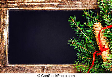 Christmas  Fir Tree Branch on  Vintage Blackboard with cone and