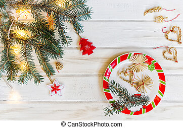 Christmas fir tree branches on white rustic wooden background with copy space for text
