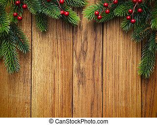 Christmas fir tree on wooden board