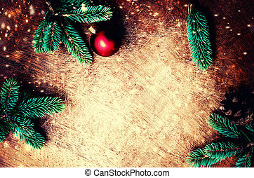 Christmas fir tree with decoration and snowflakes on dark wooden background. Top view. Flat lay