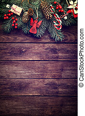 Christmas fir tree with decoration on dark wooden background