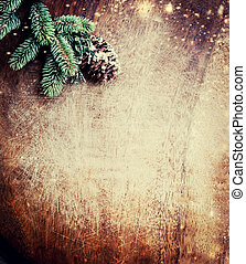 Christmas fir tree with decoration on dark wooden background. Top view. Flat lay. Xmas Festive Card