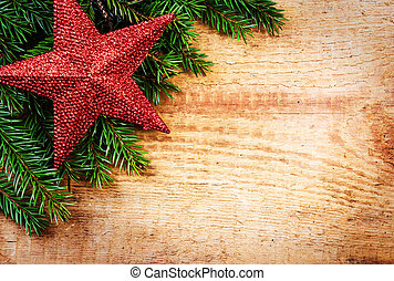 Christmas fir tree with decoration on wooden board. Vintage fram