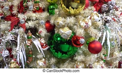 christmas fir tree with decorations - Spinning christmas...