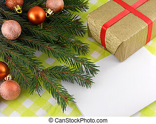 Christmas fir tree with golden gift box and empty paper
