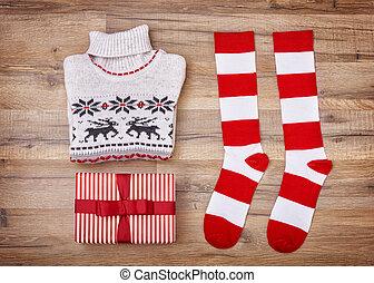 Christmas flat lay. Winter Christmas clothes and gift box.