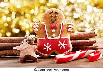 christmas gingerbread man on wooden table