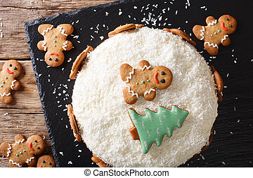 Christmas food: ginger cake with cheese cream close-up. horizontal top view