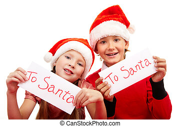 Christmas foretaste - Happy children holding letters with...