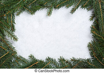 Christmas frame background with fir branches, snow and copyspace