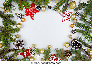 Christmas frame from fir branches and christmas decorations. Flat lay Happy new year composition from christmas toys on white wooden background. Trendy mockup copy space. Top view