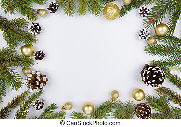 Christmas frame from fir branches and cones. Flat lay Happy new year composition from cones and golden balls on white wooden background. Trendy mockup copy space. Top view