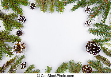 Christmas frame from fir branches and cones. Flat lay Happy new year composition on white wooden background. Trendy mockup copy space. Top view