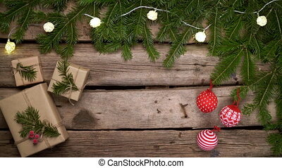 Christmas frame made of fir branches with gift boxes on ...