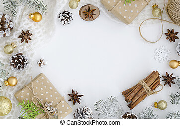 Christmas frame mockup. Hand made gift box, pine cones, fir tree branches, cinnamon sticks, anise star on white background. Top view, flat lay, copy space. hero header mockup