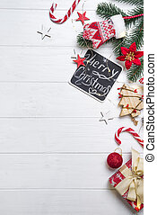 Christmas frame with candy and toys. Christmas fir branches...