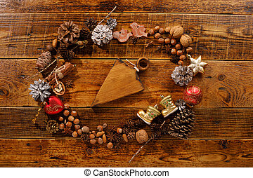 Christmas frame with copy space. Flat lay. Toys cones and New Year's decor. Place under your text. Wooden board under the text. The concept of a festive mood.