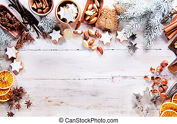 Christmas frame with spices, nuts and biscuits