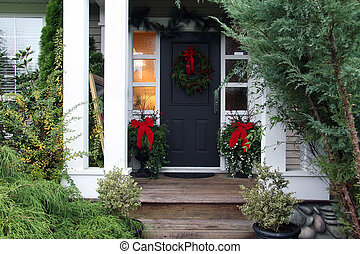 Christmas front door - Front door with a Christmas wreath...