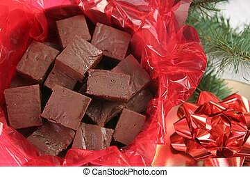 a closeup of homemade fudge in a holiday tin for gift giving