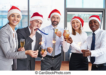 Christmas fun - Group of successful colleagues in Santa caps...