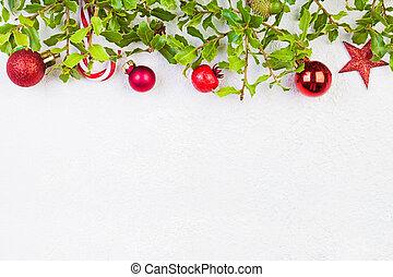 Christmas garland border on white plaster background