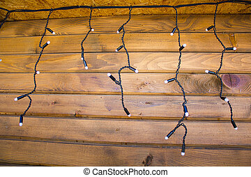 Christmas garland hanging on wooden wall