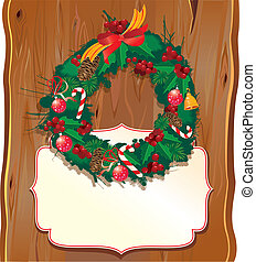Christmas garland on wooden backgro