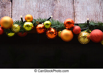 Christmas garland with baubles and lights
