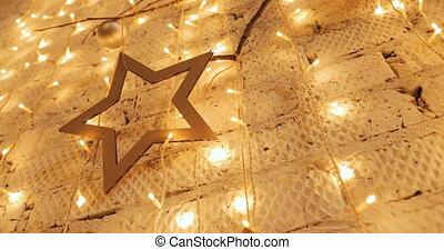 Christmas garland with Golden lights, close-up. Christmas lights. Bokeh
